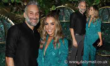Love Island's Laura Anderson looks chic in a moss green suit with beau Dane Bowers at a cabaret show