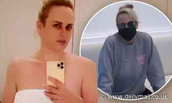 Rebel Wilson strips down to just a towel as she gets a facial