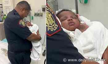 Jersey City cop is hailed a hero after catching BABY hurled off second-story balcony