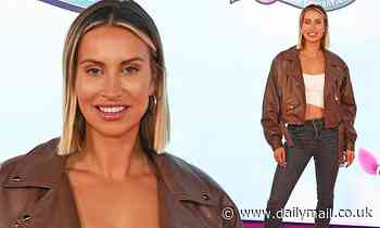 Ferne McCann showcases her toned abs in a white crop top and black jeans