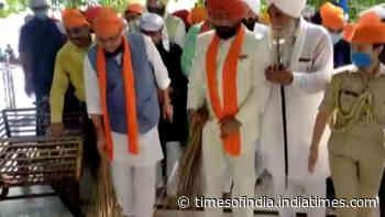 Watch: Uttarakhand Governor, Chief Minister sweep floor at Gurdwara Nanakmatta Sahib