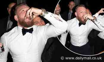 Conor McGregor knocks back shots in a tux at party in West Hollywood amid Machine Gun Kelly drama
