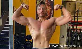 Arnold Schwarzenegger's son Joseph Baena, 23, flashes his muscles