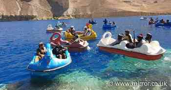 Taliban soldiers seen enjoying sun on flamingo pedal boats with assault rifles
