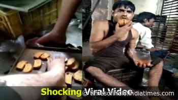 Watch: Factory workers put feet on toast, lick them