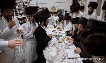 First-born great-grandson of Orthodox Rabbi is presented on silver platter adorned with jewelry