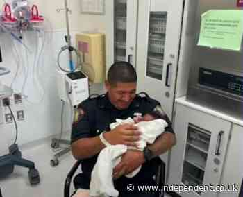 Police catch baby thrown from second floor of building by enraged man