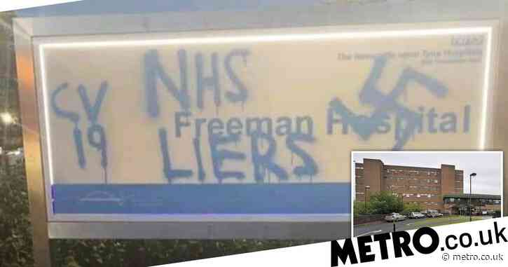 NHS workers called 'liers' by vandals who sprayed Swastika on hospital sign