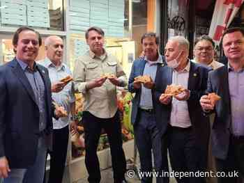 Unvaxxed Bolonsaro forced to eat pizza on New York sidewalk amid covid restaurant vaccination rules