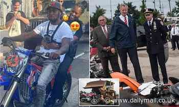 NYPD officer riding on the back of a dirt bike at Brooklyn block party is suspended without pay