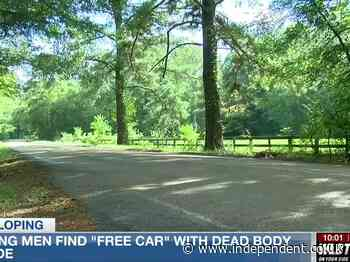 Men take vehicle with 'free car' sign for a spin and find body in the trunk