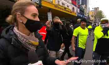 Brave moment Channel Nine reporter stares down anti-vax protestors and says she won't be intimidated