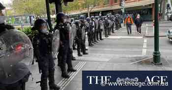 Riot police clash with protesters at Shrine