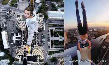 Adrenaline junkie does handstand on roof of Moscow skyscraper before slipping during somersault