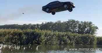 Stuntman rushed to hospital with broken spine after flying BMW 131ft over river