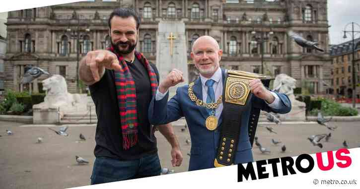 WWE's Drew McIntyre kisses ground outside Glasgow airport and exchanges gifts with Lord Provost in epic homecoming