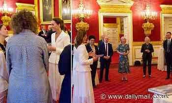 Dazzling Duchess! Kate Middleton wows in crisp white blazer and pleated midi skirt at Hold Still