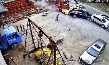 Driver dashes out of the way as lorry ploughs into a line of stationary traffic in China