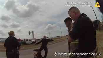 Firefighter caught on camera kicking mentally ill man in the head after he started fire