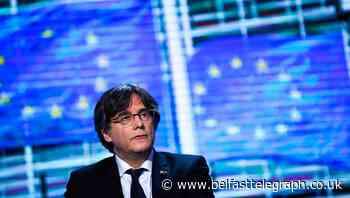 Ex-Catalan leader Carles Puigdemont detained in Italy