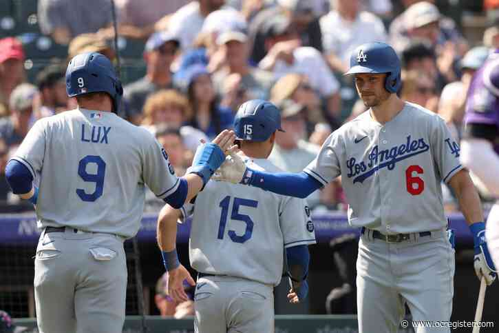 Down to their last out, Dodgers rally to win in extra innings