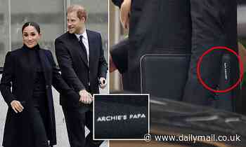 Proud dad! Harry carries laptop bag with 'Archie's papa' embossed on the side during NYC tour