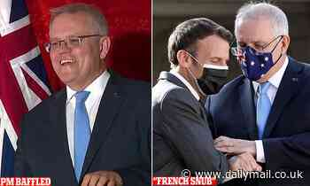 Moment that left ScoMo stumped: Baffled PM is posed a question in French and is left floundering