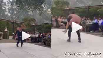Bride and Groom go crazy on their wedding day, fall off stage while dancing- Watch viral video