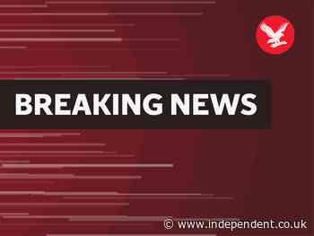 Four shot as gunmen open fire inside court hearing for 'most wanted gangster in Delhi'