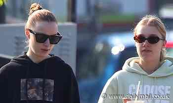 Phoebe Dynevor and sister Harriet grab iced coffees while enjoying a stroll around London