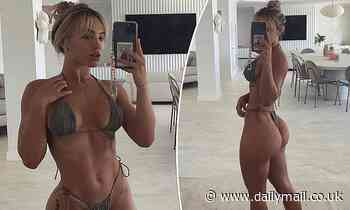 Tammy Hembrow shows off her trim and toned figure and famous derrière in a tiny string bikini