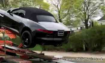 New $40,000 Jaguar is totalled when it slides off delivery lorry and smashes into a Chevy truck