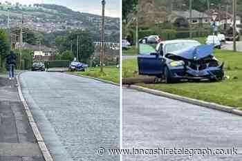 Car wrecked as it crashes into street pole