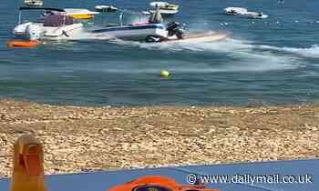 Moment driver loses control of speedboat and flies OVER another boat near a busy beach in Croatia