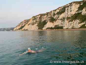 Hove doctor completes Channel swim with £10,000 for charity