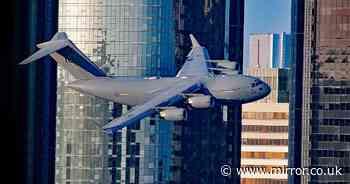 Air Force jet weaves between skyscrapers in stunt that gave witness '9/11 flashbacks'