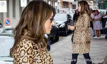 Elizabeth Hurley catches the eye in chic leopard print coat in Milan with son Damian