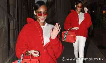 Winnie Harlow nails street style in a red teddy bear jumper and Prada trainers in Milan