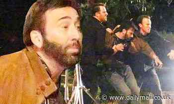 Nicolas Cage films movie scene where he is restrained by two men... a week after 'booze-filled row'