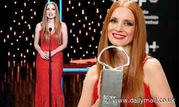 Jessica Chastain looks glamorous as she accepts Silver Shell award for In The Eyes of Tammy Faye
