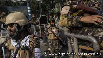 Taliban hang body in Afghan city square - Armidale Express