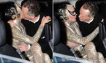 TALK OF THE TOWN: Daphne Guinness is spotted getting into a clinch in the back of a limo in Mayfair