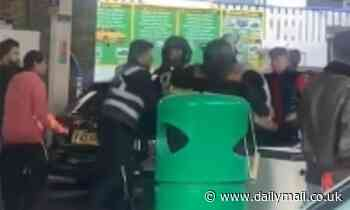 Moped rider launches flying kick against another rider as anger boils over at packed petrol station