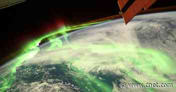 Earth glows mystical green in epic aurora image from the International Space Station     - CNET