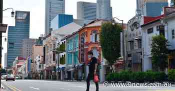 Coronavirus Singapore update: Jump in cases despite 80 percent vaccination; COVID-19 restrictions reintroduced - 9News