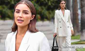 Olivia Culpo is all business in an oversized white double-breasted suit while out in Beverly Hills