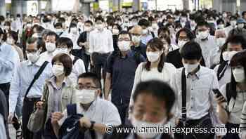 Japan seeks to end COVID emergency - Armidale Express