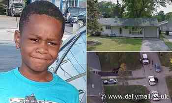 Chicago boy, 8, is shot dead while playing on porch by gunman targeting his older brother