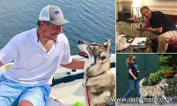 Andrew Cuomo and dog 'Captain' relax on a boat after former governor 'tried to give the dog away'