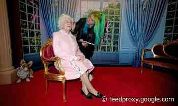 Queen's 23 stone wax figure makes 'dramatic entrance' after arriving on a carriage